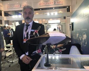 Zeva Aero CEO Stephen Tibbitts with a model of the company's Zero eVTOL aircraft.