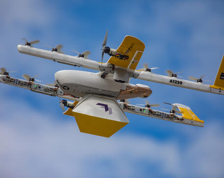 Wing delivery unmanned aircraft